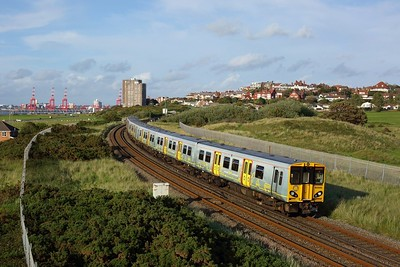 507033 leads 507015 on 2W22 1908 New Brighton to West Kirby passes Wallasey on 19 July 2020