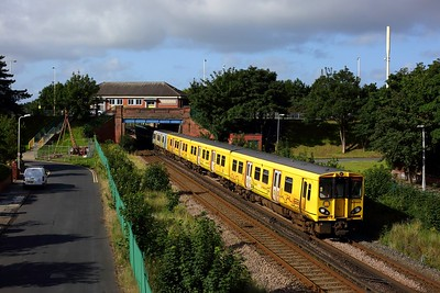 507005 leading 508124 on the 2S03 0813 Liverpool Central to Southport at Hillside on 19 July 2020