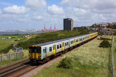 508127 leads 508112 on the 2W14 1308 New Brighton to West Kirby away from Night Brighton at Wallasey on 19 July 2020