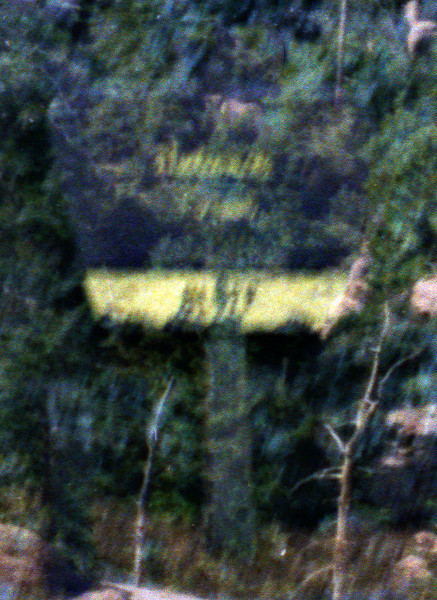"Bluff Camp ""ghost"" sign: I had a film / camera malfunction the last few frames and did not (I thought) get an image of the sign at Bluff Camp on December 24, 1985. Twenty six years later (December 11, 2011) I examined the ""unprintable"" negatives I recovered in August 2011 from a plastic box that had been stored in Ojai for more than 20 years. To my great surprise I found enough of a latent image to pull the sign out - sort of. Close enough - the word ""Bluff"" is sufficiently legible to provide evidence of a successful trip. If you have ever made the commitment to get to the site you understand my consternation at missing this shot. This image helps ease the pain somewhat."