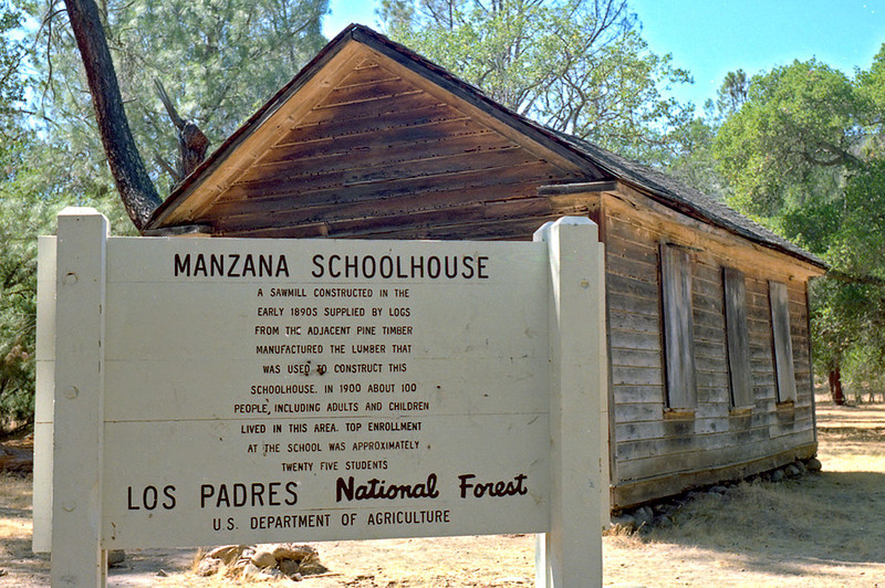 Manzana Schoolhouse, April, 1984 - the history of this odd spot is on the sign.