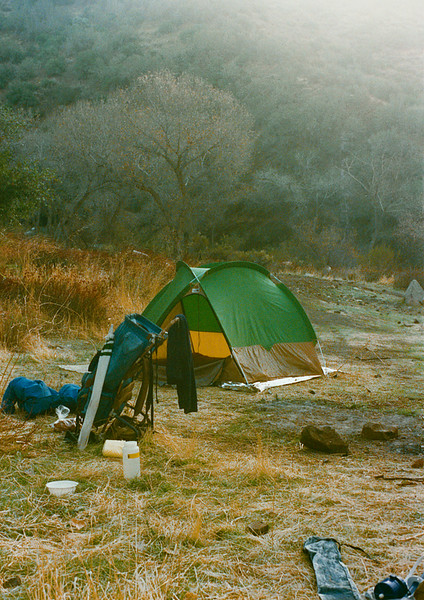 Camp at Sespe Hot Springs, 12/1986. I have had this labeled incorrectly for a long time. Jon has the correct ID in the comments and the sequence of the negatives from the trip, recovered in August, 2011 confirm this. Note 1980 vintage North Face VE 23 tent. Also note the Jansport D2 frame pack. In the lower right foreground corner is a first generation First Need water filter.