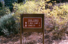 Trail sign to 3 Mile camp at Haddock camp, Pine Mountain, 11/1984. Pine Mountain Lodge camp and Lions would lie beyond on the Piedra Blanca Trail, also, the route to Fishbowls camp from Pine Mountain Lodge.
