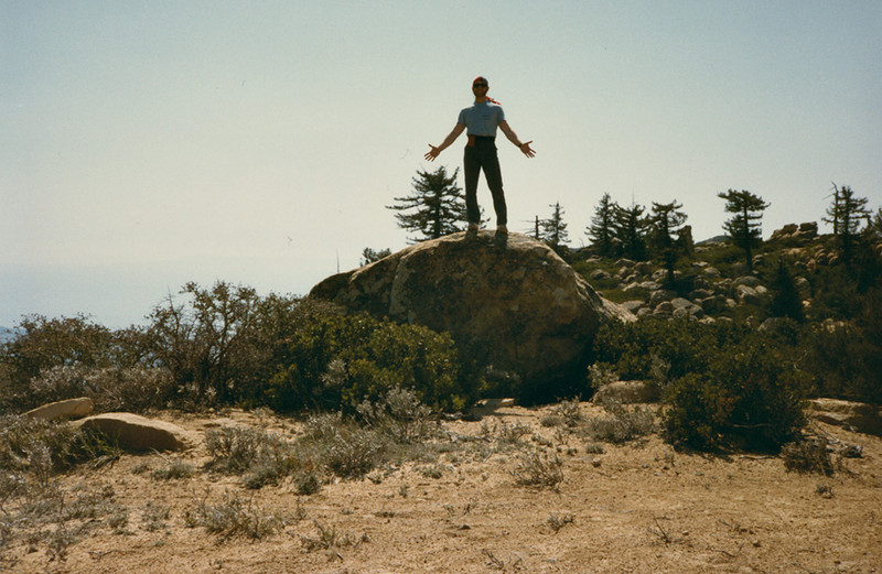 Standing on a boulder approaching Divide Peak (this is not Divide Peak); why I would choose to stand this way looking thoroughly absurd is a mystery lost in time. April, 1984.