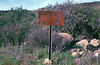 Sign at Indian Canyon trailhead, 04/1985. The slide is in very poor condition, but if you look at a larger version of this scan, you can make out entries for Lower Buckhorn Camp, Buckhorn Road, Little Pine Mountain, and Indians Camp.