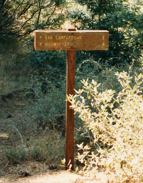 Trail sign at Chorro Grande camp. August, 1985.