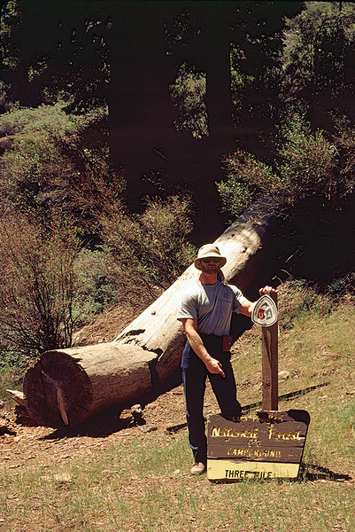 "Three Mile Camp, Pine Mountain, 06/1985. I'm sure there was a good reason why I was pointing at the sign; I happen not to know what  that reason might have been. As of July, 2011,    <a href=""http://1.bp.blogspot.com/-htga8CyJp9k/TfkVIUCAxaI/AAAAAAAAA0M/qNaoBoItTo4/s1600/IMG_1033.jpg"">this sign still exists</a>; I am surprised entropy has not fully reclaimed it. Read the story at the <a href=""http://vccanyoneering.blogspot.com/2011/06/06-10-2011-gene-marshall-trail.html"">Ventura County Canyoneering Club</a> blog."