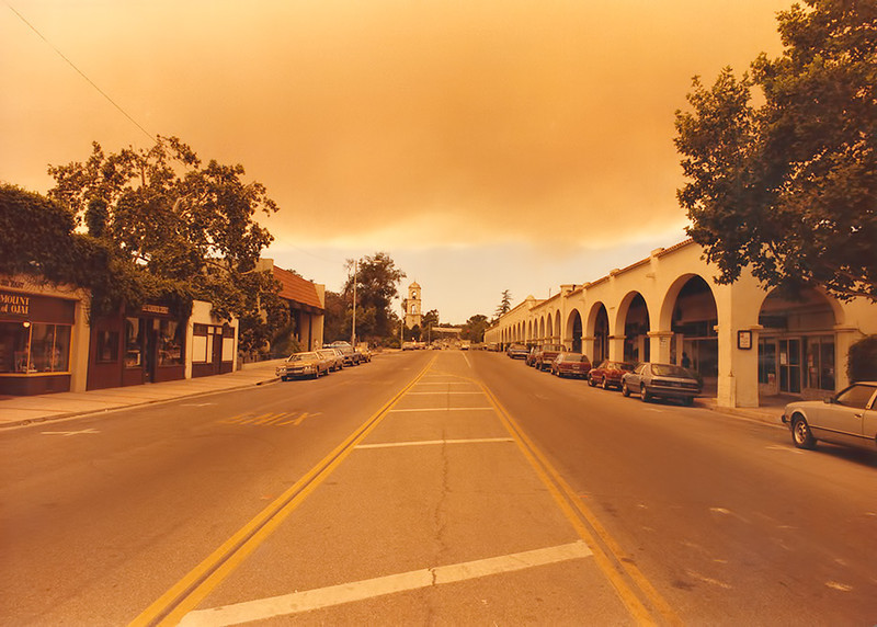 Ojai Arcade during the Wheeler Fire, 1985. The color is accurate; everything was an orange - yellow and ash was on every surface, not to mention one's lungs. The ash-fall actually killed the almond trees I used for years as my source of almonds - no grocery store needed.