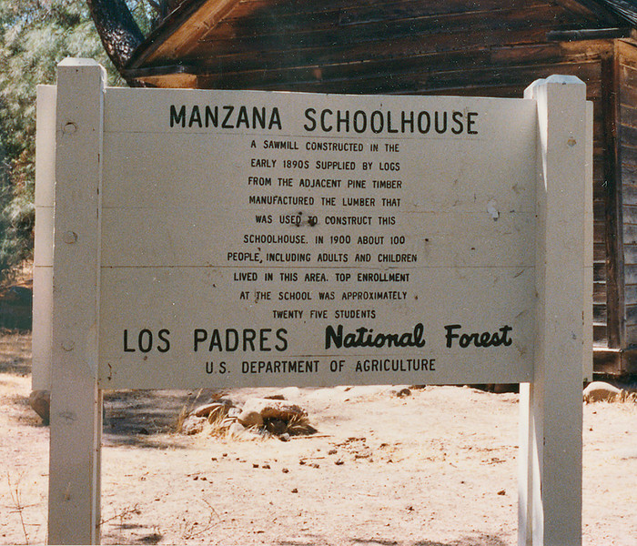 The sign at Manzana Schoolhouse, April 1984.