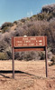Trail sign on the Red Reef Trail where it hits the Chief Peak road above White Ledge camp, 12/1981. At this point the road and the trail are the same. More or less like Highways 1 and 101 from Oxnard to San Luis Obispo.