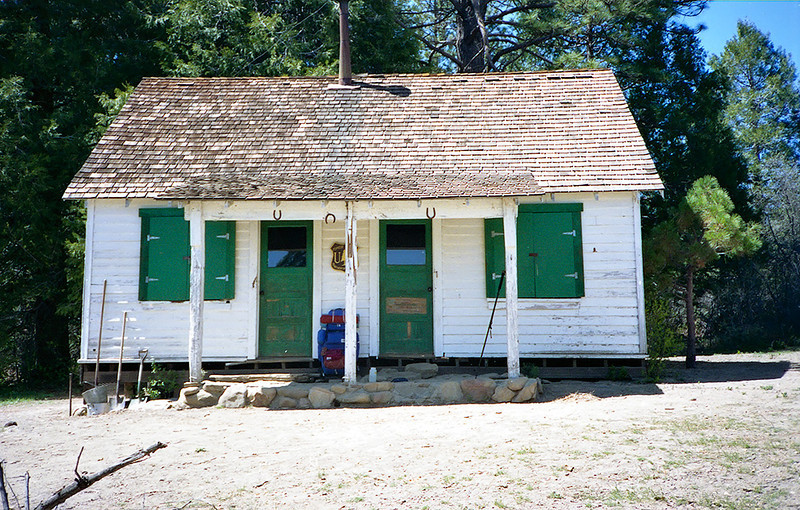 Madulce Cabin: glass windows, green storm shutters, shingled roof, wood burning stove, kitchen, sleeping area. It had it all. The kitchen area was through the door on the left, the sleeping quarters through the door on the right. Welcome home, adventurer.