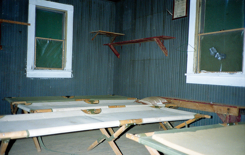 This is a view of the sleeping quarters in Madulce Cabin. The cots are a fine example of the old wood and canvas military style. I used such cots for ages and in my opinion they were as comfortable as any bed. Learning to deploy one quickly was like learning to light a Svea 123 with one match: it showed you were on the team.