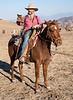 "Dick Gibford, The Cowboy Poet, works the ranch at Salisbury Portero with his equine partner, Ramblin' Jack Elliot while contemplating Craig R. Carey's book, ""Hiking and Backpacking Santa Barbara and Ventura."" November 2, 2013."