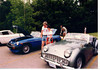 Kevin & Ginny Berichon with their Triumph next to Mr Moore's 76 MGB.<br /> Note, the guy with the beard & long hair behind the blue MGB is Craig Peck.