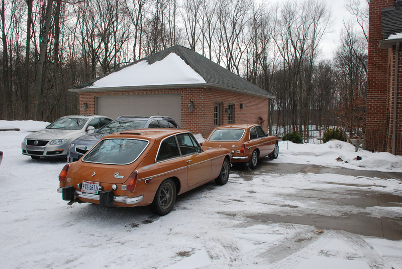 Proof that it's possible to drive an MG year round. They're both 1974 model MGB-GTs, in Bracken, the one in the front is an early '74 owned by Dave D, the one in the rear is a late '74 with the Sabrina overriders, owned by Ted S.