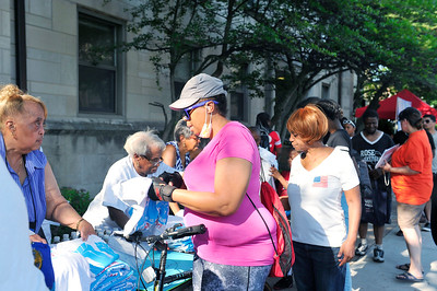 "SAINT SABINA HOST A RALLY & MARCH ""ENOUGH IS ENOUGH"" BEGINNING AT SAINT SABINA CHURCH ON 78TH PLACE & RACINE. ""FATHER PFLEGLER ACTIVIST & COMMUNITY LEADER "" IS LEADING THE CAUSE AGAINST THE YOUTH OF CHICAGO BEING GUNNED DOWN BY GANG MEMBERS AND THE POLICE AS WELL.SPECIAL GUEST INCLUDE CHANCE THE RAPPER & JENNIFER HUDSON PHOTOGRAPHER VALERIE GOODLOE"