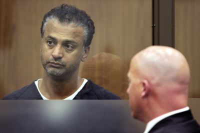 "Actor Shelley Malil, 43, left, appears at his felony arraignment in Vista Superior Court  She is expected to survive on Wednesday Aug. 13, 2008 in Vista, Calif. The actor best known for his part in ""The 40-Year-Old Virgin"" has been charged with attempted murder after his girlfriend was stabbed more than 20 times, authorities said. His defense attorney Sean Leslie is seen at right.  (AP Photo/San Diego Union-Tribune, Scott Linnett)  ** MANDATORY CREDIT.NO SALES. ONLINE OUT. NO ARCHIVING, SAN DIEGO COUNTY OUT, TV OUT, MAGS OUT, NO FORNS.  TABLOIDS OUT. WIDE WORLD OUT. COMMERCIAL INTERNET USE OUT **"