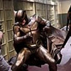 Nite Owl II (PATRICK WILSON) fights off a rioting prisoner as Silk Spectre II (