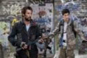 """Noah Wyle, left, and Drew Roy in a scene from the sci-fi series """"Falling Skies,"""" which premieres Sundays, at 9 p.m. EDT on TNT."""