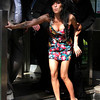 In this March 17, 2009 file photo, British singer Amy Winehouse is assisted as she leaves Westminster Magistrates Court in London, where she pleaded not guilty to a charge of common assault, over an incident at a charity ball.