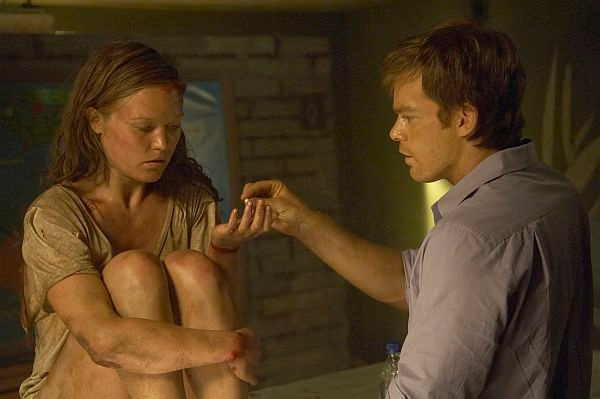 "Julia Stiles and Michael C. Hall in ""Dexter."""