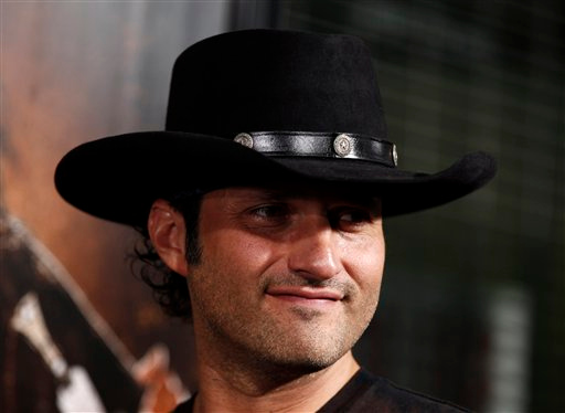 """Robert Rodriguez is the director of Mason Cook is shown in a scene from """"Spy Kids: All the Time in the World in 4D,"""" in which he is using """"Aroma-Scope,"""" to add scents to the film. (AP Photo/Matt Sayles, file)"""