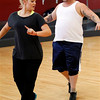 "Chaz Bono, right, and Lacey Schwimmer practice dance steps while rehearsing for the upcoming season of ""Dancing of the Stars"" in Los Angeles, Wednesday, Sept. 7, 2011. (AP Photo/Matt Sayles)"