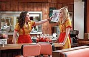 "In this image released by CBS, Kat Dennings, left, and Beth Behrs are shown in a scene from the comedy series ""2 broke Girls,"" premiering Monday, Sept. 19, 2011 on CBS."
