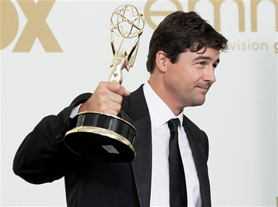"""Friday Night Lights"" cast member Kyle Chandler holds the Emmy for best lead actor in a drama series backstage at the 63rd Primetime Emmy Awards on Sunday, Sept. 18, 2011 in Los Angeles. (AP Photo/Jae Hong)"