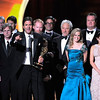 """Steven Levitan, center, and the cast and crew of """"Modern Family"""" accept the award for outstanding comedy series at the 63rd Primetime Emmy Awards on Sunday, Sept. 18, 2011 in Los Angeles. (AP Photo/Mark J. Terrill)"""