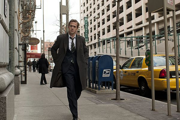 Stephen (Ryan Gosling) gets a phone call for a secret meeting in Columbia Pictures THE IDES OF MARCH.