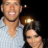 Kim Kardashian has a penchant for dating professional athletes. She is seen here with Dallas Cowboys football player Miles Austin in a July 12, 2010 file photo. (Photo by Charley Gallay/Getty Images)