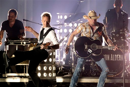 "Jason Aldean performs ""Tattoos On This Town"" during the 45th Annual CMA Awards in Nashville, Tenn., on Wednesday, Nov. 9, 2011. (AP Photo/Mark Humphrey)"