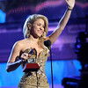 """Shakira accepts the award for best female pop vocal album for """"Sale El Sol"""" onstage at the 12th Annual Latin Grammy Awards on Thursday Nov. 10, 2011 in Las Vegas. (AP Photo/Julie Jacobson)"""