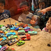 "Youngsters peer into a display case containing die-cast vehicles from the Cars movies while visiting the ""From Silver Screen to Die-cast: Disney Pixar Cars Imagined by Mattel"" exhibition at the Petersen Automotive Museum in Los Angeles, CA.  More than 500 unique designs that represent characters from the films have been produced.(Andy Holzman/Daily News Staff Photographer)"