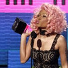 "Nicki Minaj accepts the rap/hip-hop favorite album award for  ""Pink Friday"" at the 39th Annual American Music Awards on Sunday, Nov. 20, 2011 in Los Angeles. (AP Photo/Matt Sayles)"