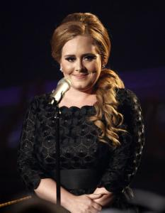 In this Aug. 28, 2011 file photo, singer Adele is shown at the MTV Video Music Awards in Los Angeles. Adele's miserable love life has brought her heavenly success this year: The mournful album  21  is year's best-selling album with over 4 million copies sold and has resulted in two smash singles, Rolling in the Deep  and  Someone Like You.  The Recording Academy will likely add to Adele's good year on Wednesday when it announces its Grammy nominations on Wednesday  evening.