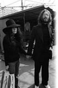 Former Beatle John Lennon and his wife Yoko Ono visit the Paris flea Market on March 22, 1969.
