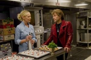 "In this film image released by Warner Bros. Pictures, Katherine Heigl, left, and Jon Bon Jovi are shown in a scene from ""New Year's Eve."" (AP Photo/Warner Bros. Pictures, Andrew Schwartz)"