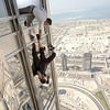 "There's a big of hanging around in ""Mission: Impossible -- Ghost Protocol"" for Jeremy Renner and Tom Cruise."
