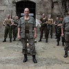 "Ralph Fiennes, center, and Gerard Butler star in ""Coriolanus."""