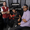 In this Jan. 4, 2012 photo, Ari Levine, left, Bruno Mars, center, and Philip Lawrence of the songwriting and production team The Smeezingtons, pose for a portrait at their recording studio in the Hollywood section of Los Angeles. (AP Photo/Chris Pizzello)