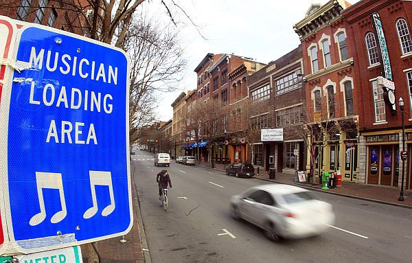 This Feb. 15, 2012 photo shows a sign bearing music notes in Nashville, Tenn. The guitar, an iconic symbol of Nashville's music scene, is beginning to play second fiddle as the city's visual ambassador. Music notes and symbols are emerging in Nashville's logo as city promoters seek to illustrate the variety of music, in addition to country music, that is made in the city. (AP Photo/Mark Humphrey)