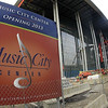 This Feb. 15, 2012 photo shows a sign bearing a music note in front of the Music CIty Center convention complex being built in Nashville, Tenn. The guitar, an iconic symbol of Nashville's music scene, is beginning to play second fiddle as the city's visual ambassador. Music notes and symbols are emerging in Nashville's logo as city promoters seek to illustrate the variety of music, in addition to country music, that is made in the city. (AP Photo/Mark Humphrey)