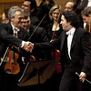 Los Angeles Philharmonic violinist Martin Chalifour, left, shakes hands with co