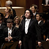 Venezuelan conductor Gustavo Dudamel, center, faces the public after directing