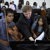 Violinist Guido Lamell, center, from the Los Angeles Philharmonic, teaches youn