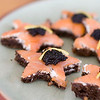 In this image taken Jan. 9, 2012 in Concord, N.H., an appetizer recipe for Smoked Salmon Stars;  a wood grilled pizza crust smeared with dill cream and topped with smoked salmon and a garnish of caviar; is shown. (AP Photo/Matthew Mead)