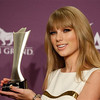 Taylor Swift poses backstage with the award for entertainer of the year at the 47th Annual Academy of Country Music Awards on Sunday, April 1, 2012 in Las Vegas. (AP Photo/Isaac Brekken)