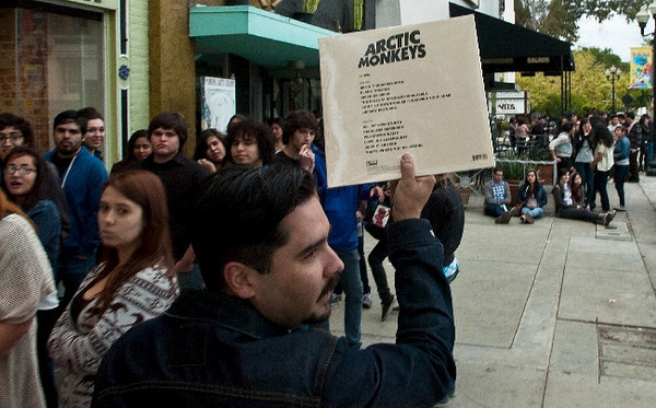 ON13-SBC-COACHELLA-01-TRC (Thomas R. Cordova/Staff Photographer) Robert Contreras try to sale Arctic Monkeys records outside of the Glass House where fans line up to see the band perform at the venue in Pomona April 11, 2012.